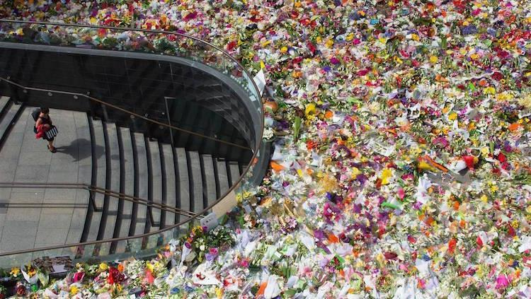 Flowers laid at site of Sydney siege