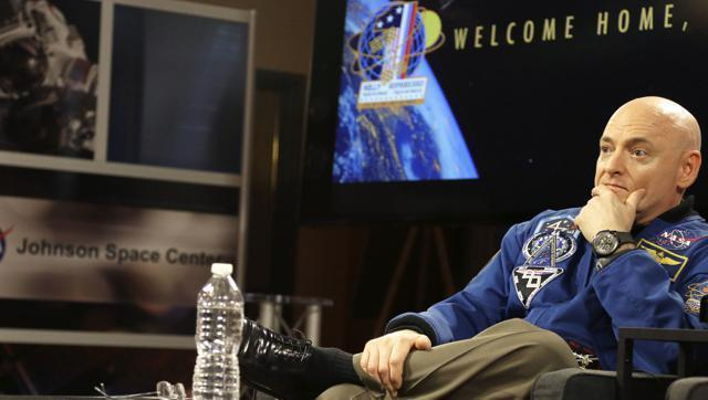 Sore, but no taller, astronaut Scott Kelly adjusts to Earth