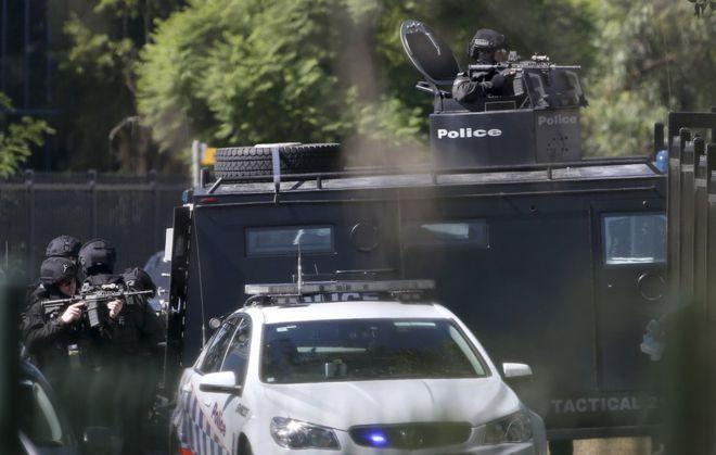 Father of gunman in fatal Sydney siege charged