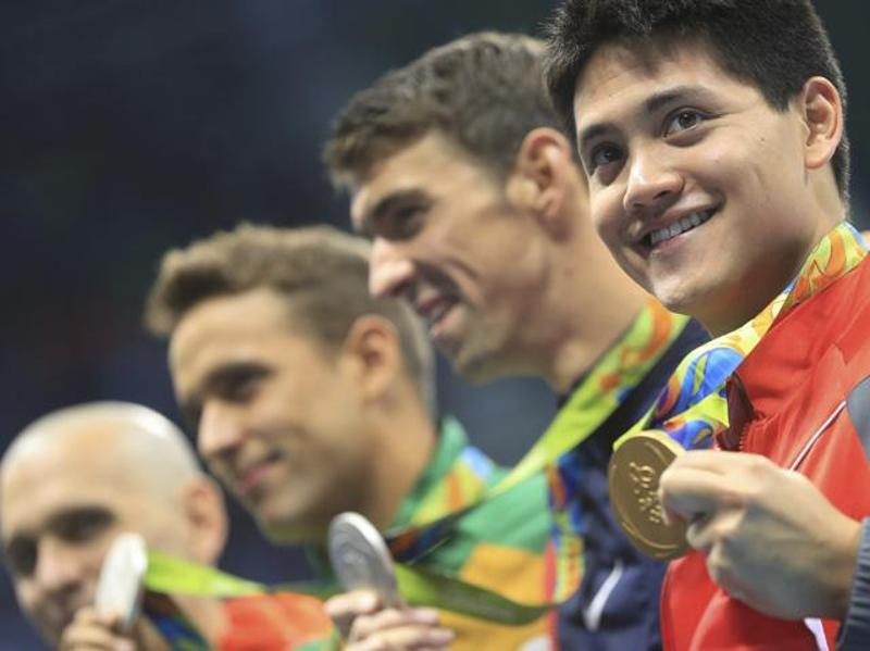Rare silver for Phelps as Singapore's Schooling outclasses his American idol