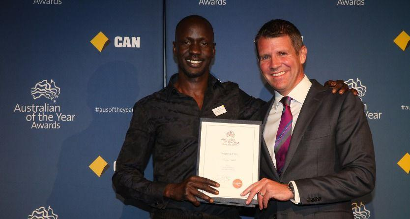 Premier Mike Baird with refugee advocate Deng Adut