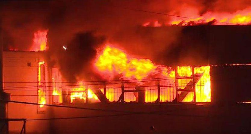 Massive fire rips through Parramatta tyre factory