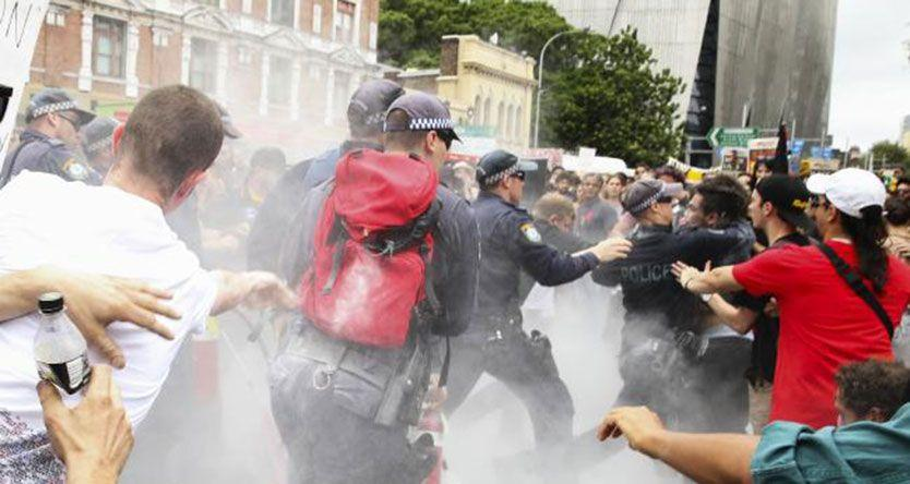 Violence and flag-burning at 'Invasion Day' protest in Sydney