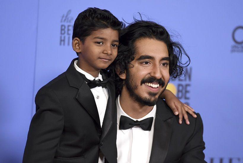 Sunny Pawar, left, and Dev Patel pose in the press room at the 74th annual Golden Globe Awards at the Beverly Hilton Hotel on Sunday, Jan. 8, 2017, in Beverly Hills, Calif. (Photo by Jordan Strauss/Invision/AP)