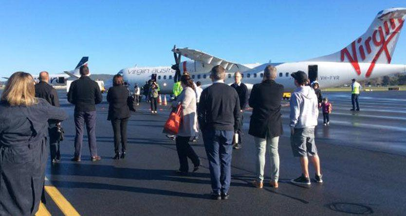 Man arrested after Virgin flight evacuated on landing at Albury airport in NSW