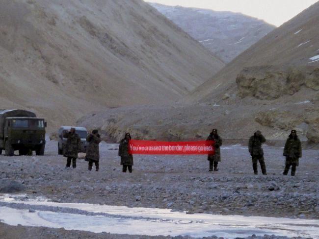 """In this May 2013 photo, Chinese troops hold a banner which reads """"You've crossed the border, please go back"""" in Ladakh, India. Picture: AP Photo, File.Source:AP"""