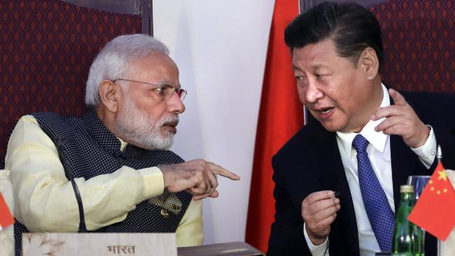 Indian Prime Minister Narendra Modi, left, talks with Chinese President Xi Jinping in 2016. Picture: AP Photo/Manish Swarup, File.Source:AP