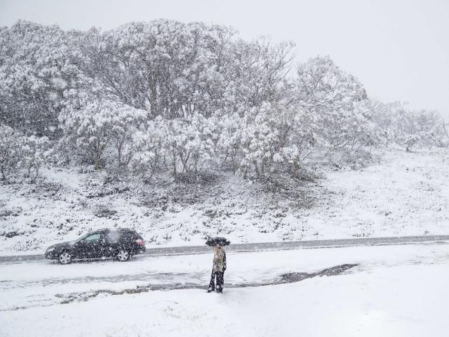 Sydney weather: Hail, storms, snow and 150mm of rain as NSW cops soaking