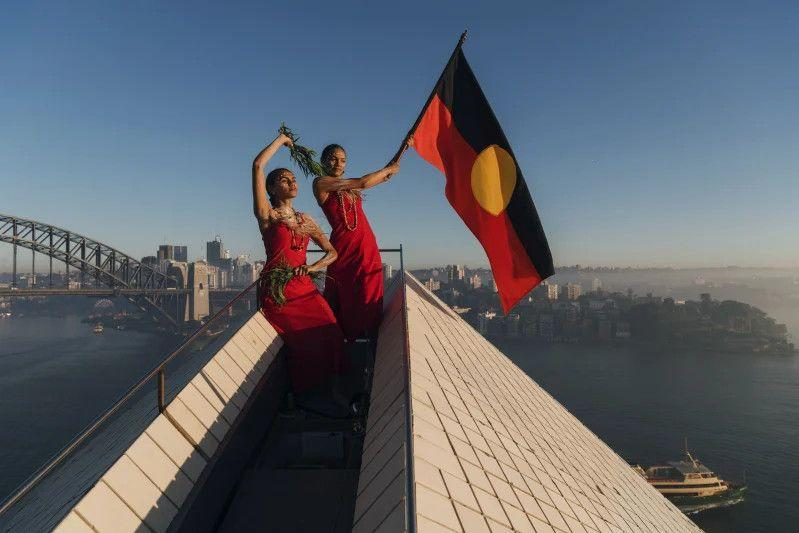 Flying the Aboriginal flag on top of the Opera House to promote Dance Rites a celebration of First Nations dance