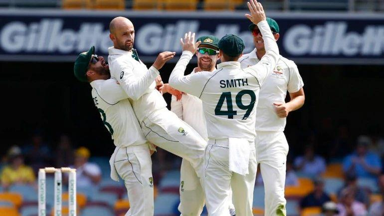 Brisbane Test-Nathan Lyon elebrates with his teammates after he got the wicket of Pakistan's Babar Azam