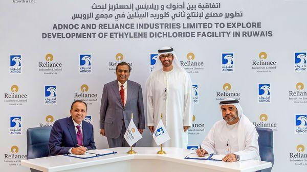 RIL Executive Director Nikhil Meswani and Adnoc's Downstream Directorate Executive Director Abdulaziz Alhajri sign an agreement to explore Ehtylene Dichloride facility in Ruwais, UAE - in presence of Chairman and Managing Director, RIL Mukesh D Ambani, and UAE Minister of State and Adnoc Group CEO Sultan Ahmed Al Jaber, in Abu Dhabi (Photo; PTI)