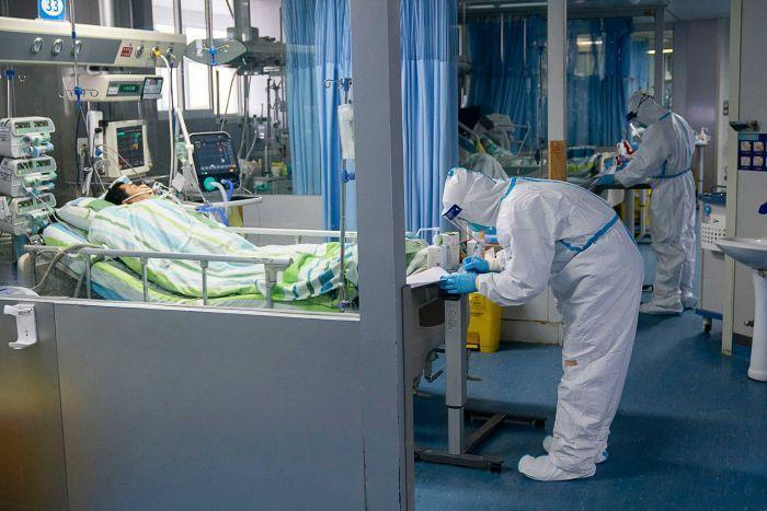 A medical worker attends to a patient in the intensive care unit at Zhongnan Hospital of Wuhan University