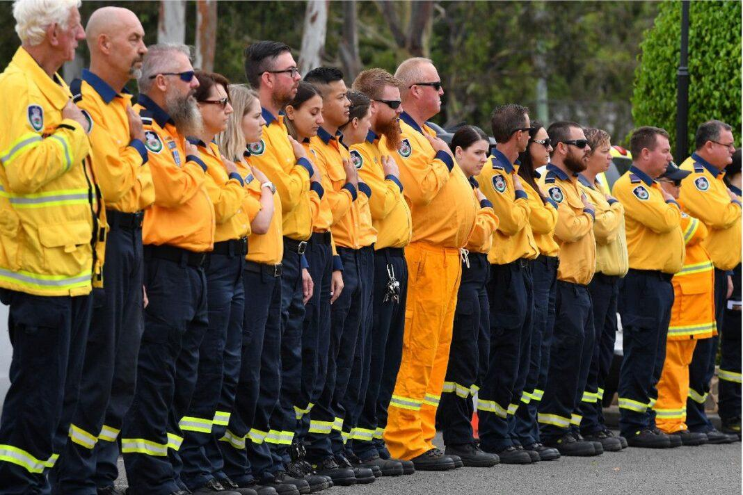 NSW RFS volunteers make an honour guard for Andrew O'Dwyer, a firefighter who died while battling a blaze in December