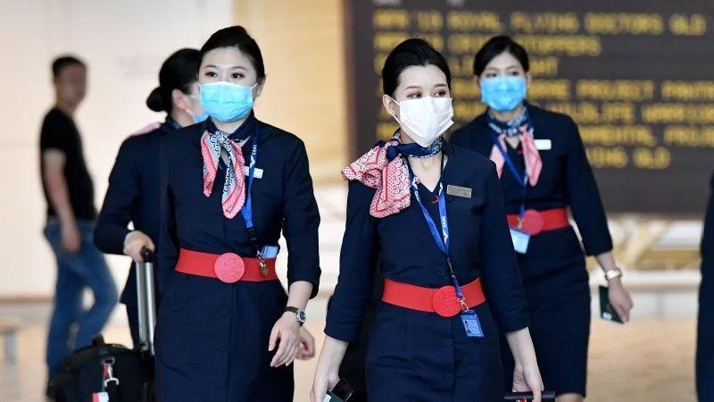 China-Eastern-Airlines-cabin-crew-are-seen-wearing-protective-face-masks-at-Brisbane-International-Airport-on-Wednesday