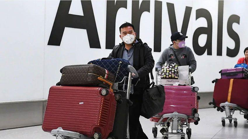 Passengers-arriving-at-airport-wearing-masks