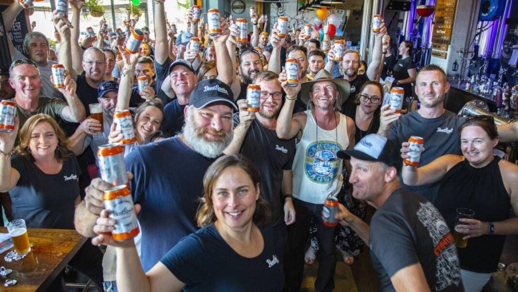 Tracey Margrain and Richard Watkins front centre celebrate their third place at the Bentspoke Brew Pub on Saturday
