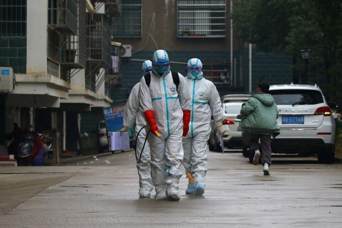 Workers from local disease control disinfect a residential area in Ruichang Jiangxi province in China