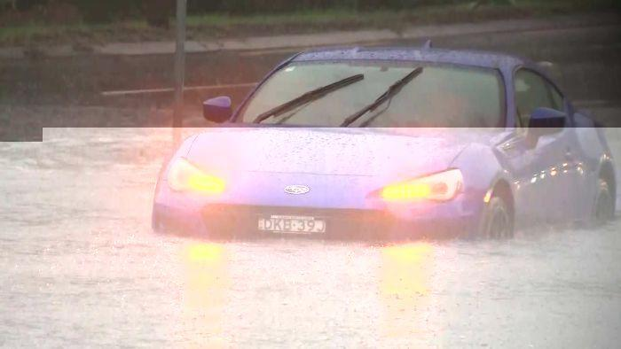 A car was trapped in floodwaters in Roseville this morning