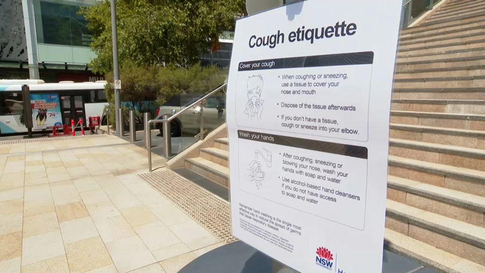 A-sign-in-Chatswood-Sydney-reminds-people-of-cough-etiquette