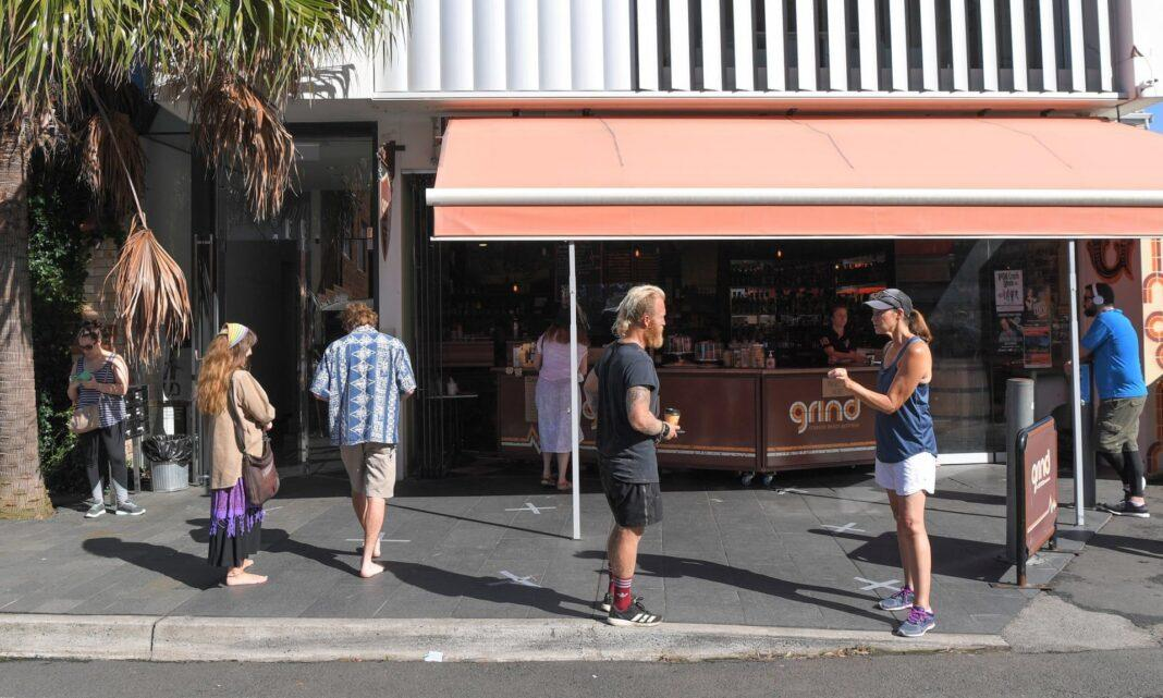 Social distancing in practice outside a cafe at Cronulla mall in southern Sydney. Scott Morrison has announced a tightening of the rules and limited gatherings to a maximum of two people.