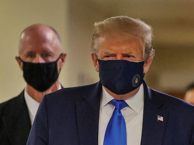 Mask not more effective than coronavirus vaccine 'by any means', says Trump