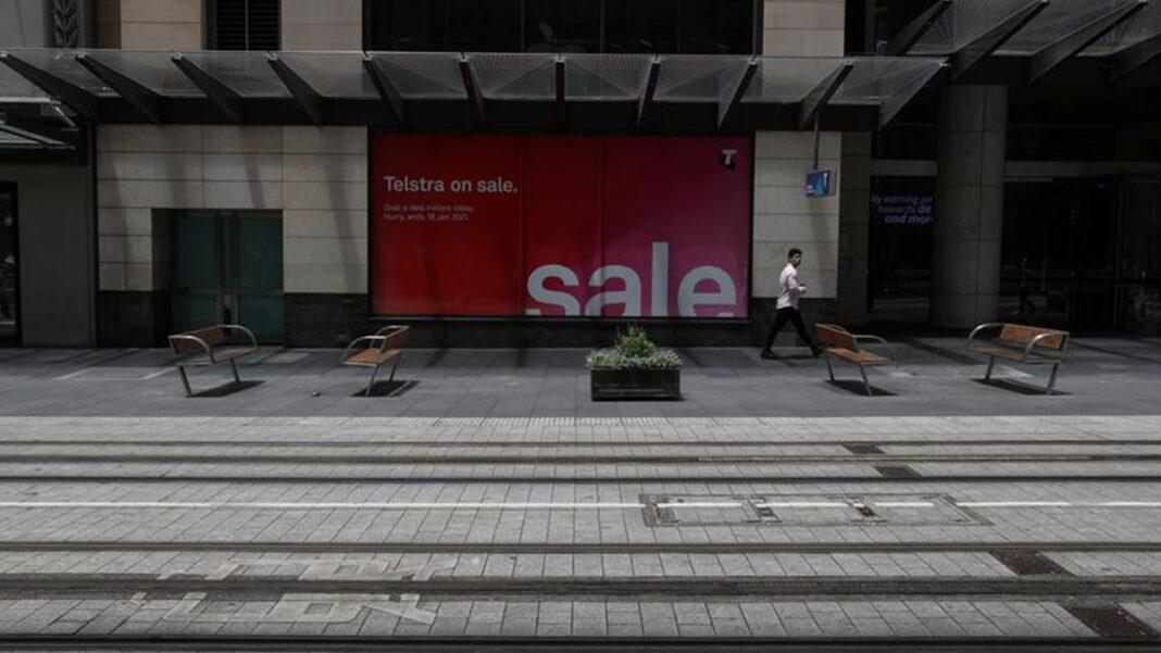 A lone person walks through a usually busy part of the city centre at lunch hour amidst the tightening of regulations to curb the spread of the coronavirus disease (COVID-19) in Sydney, Australia