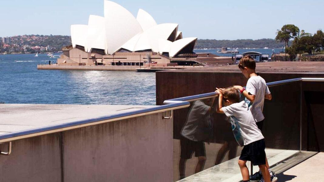 Visitors to the Museum of Contemporary Art Australia look at the view over Sydney Harbour